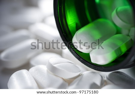 close up of pills in a bottle - stock photo
