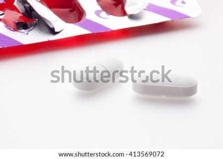 Close up of pills isolated - vitamin concept  - stock photo