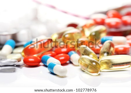 Close up of pills over white background - stock photo