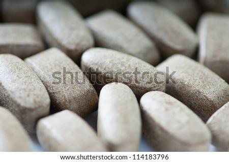 Close-up of pills, shallow DOF, studio shot - stock photo