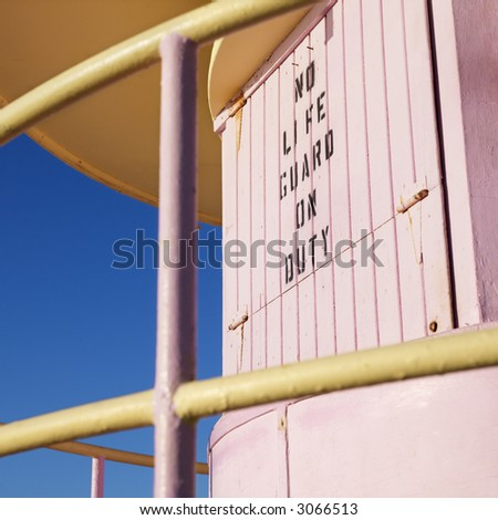 Close-up of pink art deco lifeguard tower with no lifeguard on duty sign in Miami, Florida, USA. - stock photo