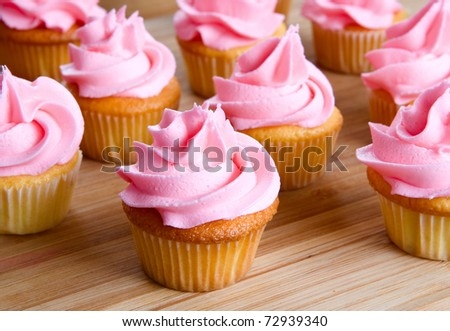 close-up of pink cupcake with icing - stock photo