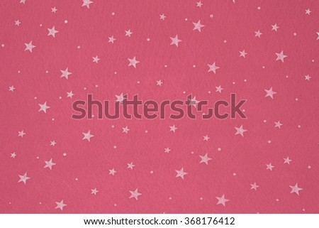 Close-up of pink felt with stars background. - stock photo