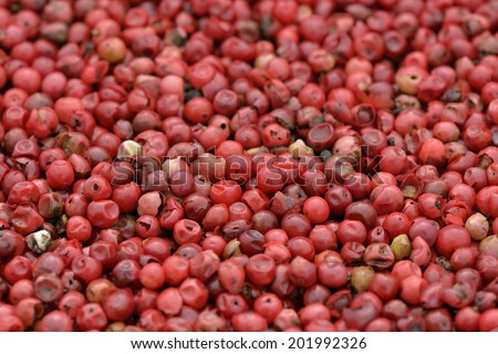 Close-up of pink peppers to use as background - stock photo