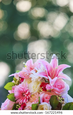 close up of pink tulip flowers bouquet with blurry copy space in vertical form - stock photo