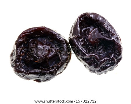 Close up of pitted prunes isolated on white background.
