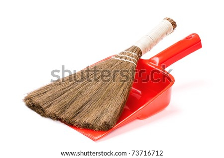 Close up of plastic red dustpan with new broom on white background - stock photo