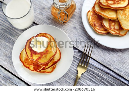 Close up of plate with a pile of home made pancakes