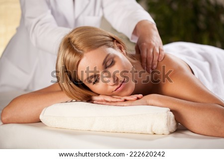 Close-up of pleasant back massage in spa room
