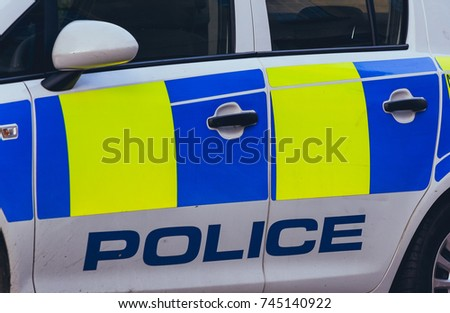 Close up of Police Car, Left Side with Police Name and Colours, horizontal photography