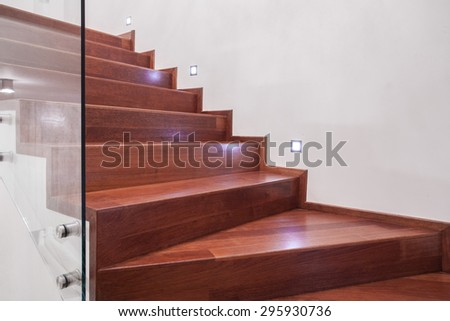 Close-up of polished wooden stairs - horizontal view - stock photo