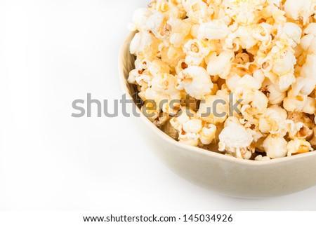 Close up of popcorns in ceramic bowl - stock photo