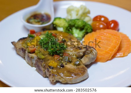 Close up of pork steak on a white plate