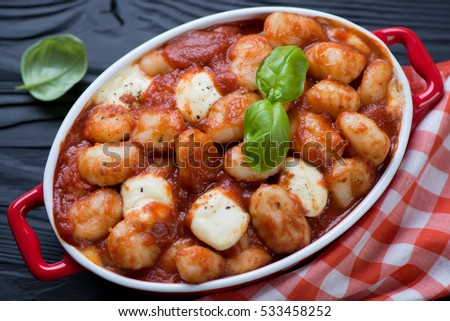 Close-up of potato gnocchi baked with tomato sauce and cheese