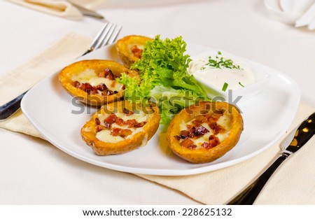 Close Up of Potato Skins with Cheese and Bacon Appetizer with Dipping Sauce - stock photo