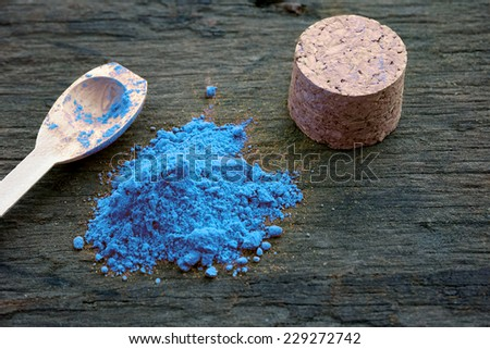 close up of powder blue paint on wooden background - stock photo