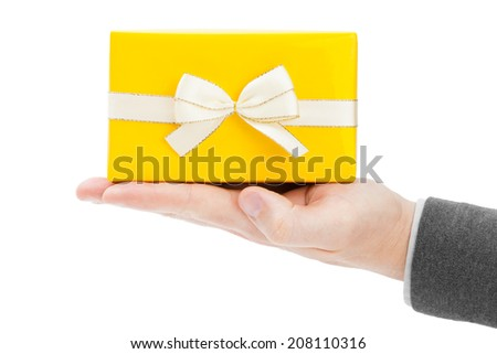 Close-up of present box on male palm - stock photo