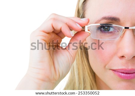 Close up of pretty blonde with reading glasses on white background