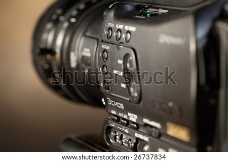 Close-up of professional digital video camera.
