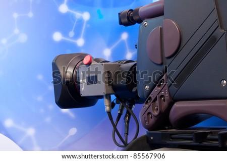 Close-up of professional digital video camera - stock photo