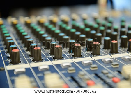 Close up of professional mixing console for music