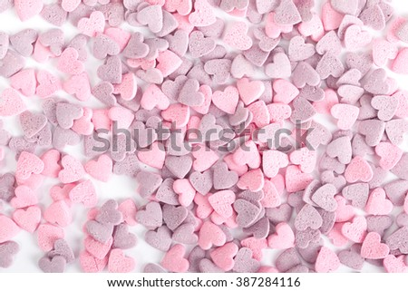 Close up of purple ad pink candy hearts - stock photo