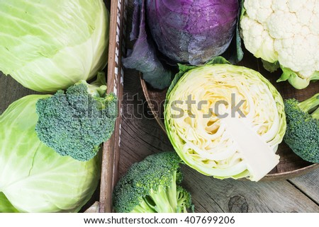 Close up of purple cabbage. cauliflower and green cabbage in a farmers crate. - stock photo