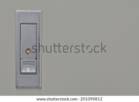 close-up of push switch for open on control box in off state ; selective focus on switch - stock photo