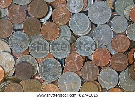 Close-up of quarters, dimes, nickels and pennies - stock photo