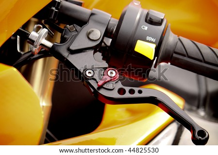 Close up of racing motorcycle handlebar and clutch lever - stock photo