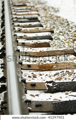 Close-up of railway ties in the wintertime - stock photo