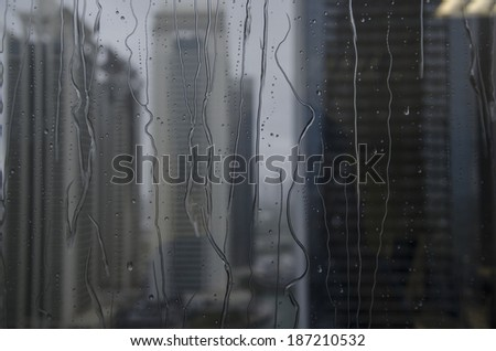Close up of rain water through window glass - stock photo