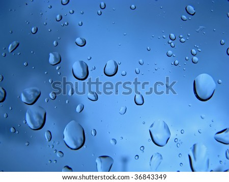 close up of raindrops on glass window - stock photo