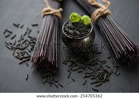 Close-up of raw black rice vermicelli, selective focus - stock photo