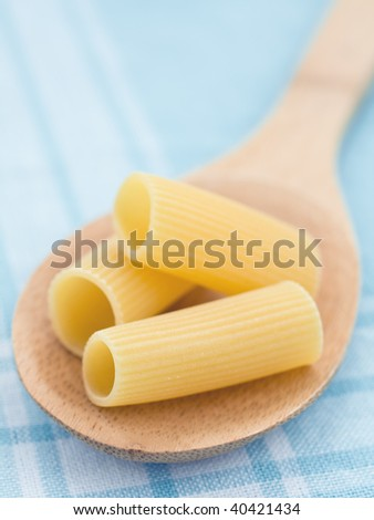 Close up of raw pasta on blue background - stock photo