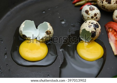 Close up of Raw Quail eggs to be fried on frying pan. whole and broken collection of egg. delicious Vegetable omelet with bulls eye fried egg. Egg decoration, food art,  topping on hot dogs, hamburger - stock photo