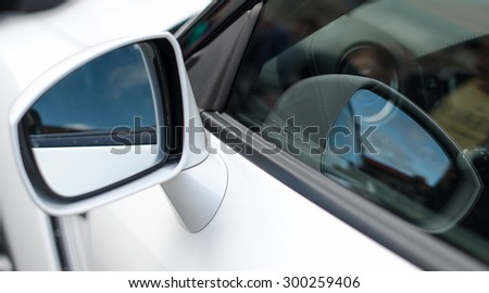 Close-up of Rear-view mirror.  Sports car part. - stock photo