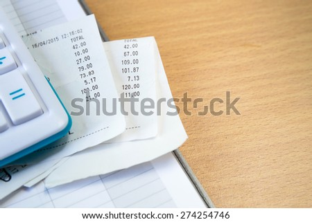 Close up of receipt paper and caculator, payment - stock photo