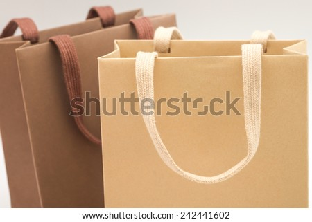 Close up of recycle dark brown and beige paper bags with retro design for putting gift on seasonal event - stock photo