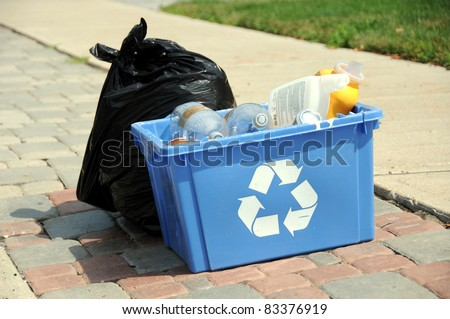 Close up of recycling and garbage on roadside for pick up - stock photo