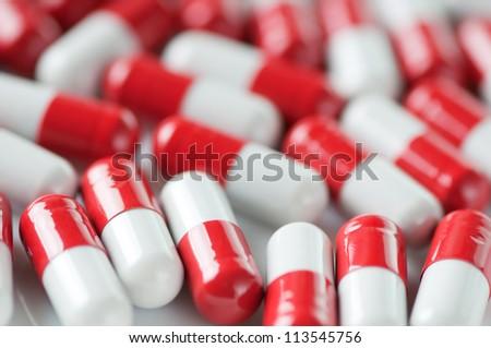 Close-up of red and white capsules, horizontal shot - stock photo