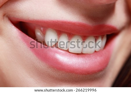 Close up of red beautiful female lips toothy smile - stock photo