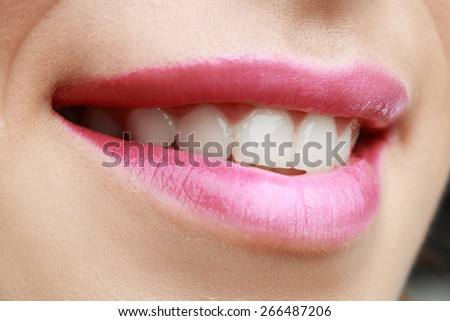 Close up of red beautiful female lips toothy smile