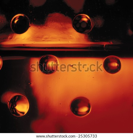 Close-up of red textured glass bottle. - stock photo