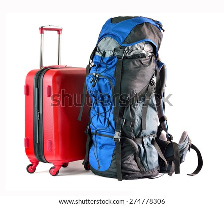 Close up of red travel luggage and big backpack isolated on white background, selective focus.  - stock photo