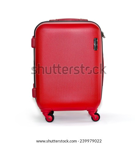 Close up of red travel luggage isolated on white background, selective focus.  - stock photo