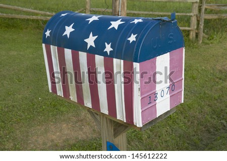 Close-up of red white and blue US flag mailbox in central GA - stock photo