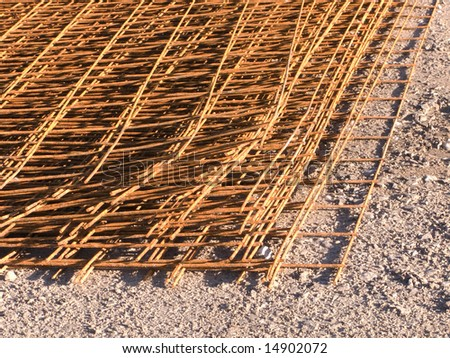 Close-up of reinforcing steel bar lying on ground - stock photo