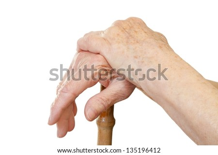 Close-up of relaxing aged hand on a stick - stock photo