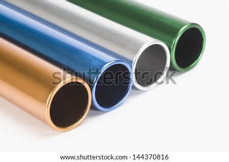 Close-up of relay batons - stock photo